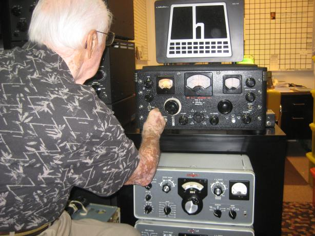 The Florida AM group presents Don WA4JLI with a BC-348Q receiver restored by Stan WA4JLI. Don had used 348s many times during the war aboard military aircraft, yet it was one of the few items he had not collected
